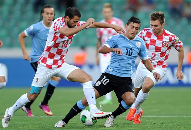 Giorgian de Arrascaeta en un partido ante Croacia. FOTO. AFP