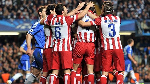 Los jugadores del Atlético celebran el gol de Diego Costa. / AFP