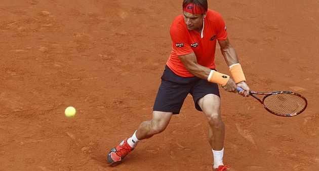 David Ferrer golpea la bola / Francesc Adelantado